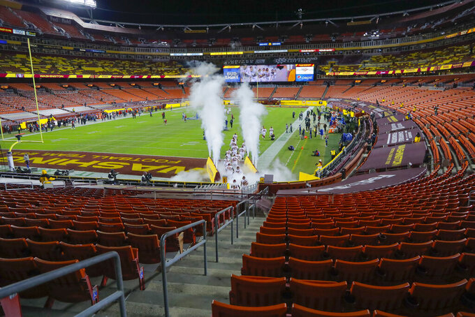 The Washington Football Team take the field at the start of an NFL wild-card playoff football game against the Tampa Bay Buccaneers, Saturday, Jan. 9, 2021, in Landover, Md. (AP Photo/Julio Cortez)