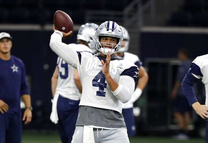 Dallas Cowboys quarterback Dak Prescott (4) throws a pass during a work out at the team's NFL football practice facility in Frisco, Texas, Thursday, Sept. 5, 2019. (AP Photo/Tony Gutierrez)