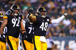 Pittsburgh Steelers linebacker Quincy Roche (48) reacts after tackling Philadelphia Eagles quarterback Nick Mullens during the second half of a preseason NFL football game Thursday, Aug. 12, 2021, in Philadelphia. (AP Photo/Matt Slocum)