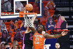 Illinois center Kofi Cockburn (21) blocks the shot of Penn State forward John Harrar (21) during the first half of an NCAA college basketball game Tuesday, Jan. 19, 2021, in Champaign, Ill. (AP Photo/Holly Hart)