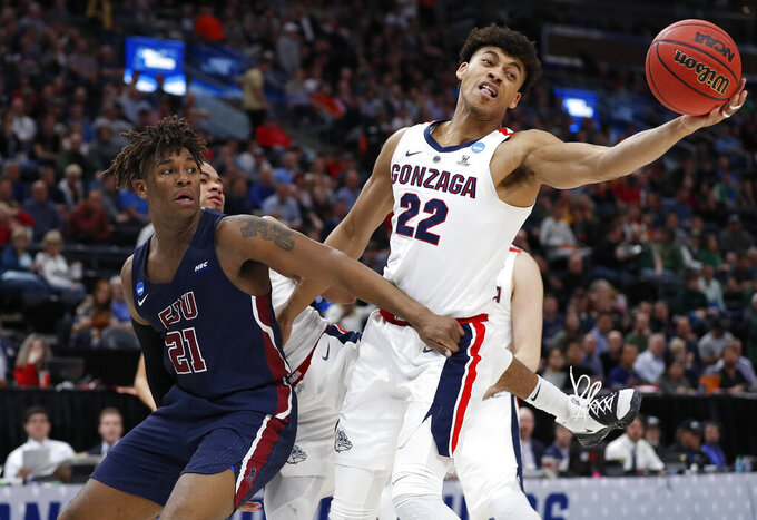Fairleigh Dickinson forward Elyjah Williams (21) and Gonzaga forward Jeremy Jones (22) go for a rebound during the second half of a first-round game in the NCAA men's college basketball tournament Thursday, March 21, 2019, in Salt Lake City. (AP Photo/Jeff Swinger)