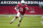 FILE - In this Sept. 8, 2019, file photo, Arizona Cardinals running back David Johnson (31) runs against the Detroit Lions during the first half of an NFL football game in Glendale, Ariz. The Arizona Cardinals have acquired three-time All-Pro receiver DeAndre Hopkins in a trade that will send running back David Johnson and draft picks to the Houston Texans, a person familiar with the situation told The Associated Press. The person spoke to the AP on condition of anonymity Monday, March 16, 2020, because the trade hasn't been officially announced. (AP Photo/Rick Scuteri, File)