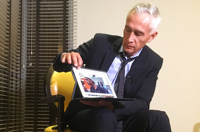 FILE - In this Feb. 25, 2019 file photo, Univision's Jorge Ramos shows a video he says his crew shot the previous day showing Venezuelan youth picking food scraps out of the back of a garbage truck in Caracas, during an interview at a hotel in Caracas, Venezuela. The Univision television network said Thursday, May 30, that it has recovered the video of a contentious interview with Venezuelan President Nicolás Maduro that was confiscated after he cut it short, angered by critical questions from journalist Jorge Ramos. (AP Photo, File)