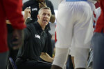 Loyola Marymount head coach Mike Dunlap talks to his player during a timout during the first half of an NCAA college basketball game against Gonzaga in Los Angeles, Saturday, Jan. 11, 2020. (AP Photo/Alex Gallardo)