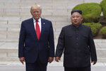FILE- In this June 30, 2019, file photo, U.S. President Donald Trump, left, meets with North Korean leader Kim Jong Un at the North Korean side of the border at the village of Panmunjom in Demilitarized Zone. Kim on Wednesday, Oct. 16, has vowed to surmount U.S.-led sanctions he says have inflicted