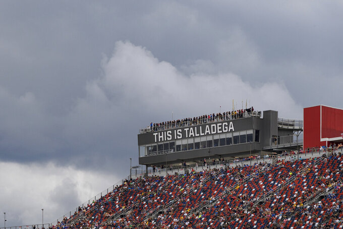Clouds hang over the grandstand at Talladega Superspeedway during a NASCAR Cup series auto race Monday, Oct. 4, 2021, in Talladega, Ala. The race was ended midway during a rain delay with Bubba Wallace who was leading at the time being pronounced the winner. (AP Photo/John Amis)