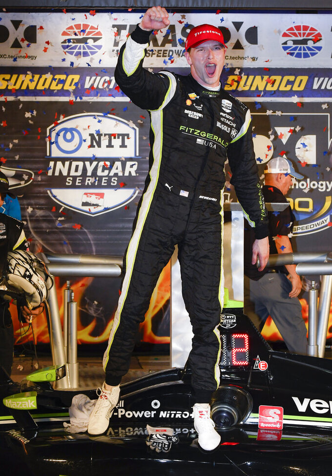 Josef Newgarden celebrates in Victory Lane after winning the IndyCar auto race at Texas Motor Speedway, Saturday, June 8, 2019, in Fort Worth, Texas. (AP Photo/Larry Papke)