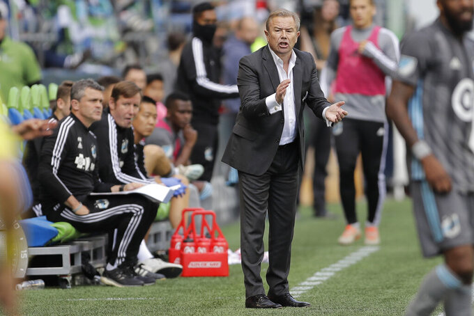 Minnesota United head coach Adrian Heath reacts on the sideline during the second half of an MLS soccer match against the Seattle Sounders, Sunday, Oct. 6, 2019, in Seattle. The Sounders won 1-0. (AP Photo/Ted S. Warren)