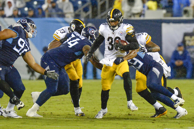 Pittsburgh Steelers running back James Conner (30) carries the ball against the Tennessee Titans in the first half of a preseason NFL football game Sunday, Aug. 25, 2019, in Nashville, Tenn. (AP Photo/Mark Zaleski)