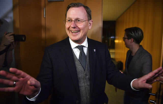 Bodo Ramelow, former Minister President of Thuringia smiles in the Thuringian State Parliament in Erfurt, Germany, Friday, Feb. 21, 2020. State lawmakers in the eastern Germany federal state cleared the way for getting a new government without the support of a far-right party. Lawmakers from several parties announced late Friday in Thuringia that they agreed to hold a new vote in parliament on the state governor next month and plan to have new state elections in April 2021. (Martin Schutt/dpa via AP)