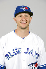 FILE - This is a 2018 file photo showing Troy Tulowitzki of the Toronto Blue Jays baseball team. Tulowitzki has been released by the Blue Jays, who owe the oft-injured shortstop $38 million for the remaining two years of his contract. Now 34, Tulowitzki has not played in the major leagues since July 2017. He was limited that year to 66 games because of a hamstring and right ankle injury. The ankle required surgery last spring and he missed the entire season. (AP Photo/John Minchillo, File)