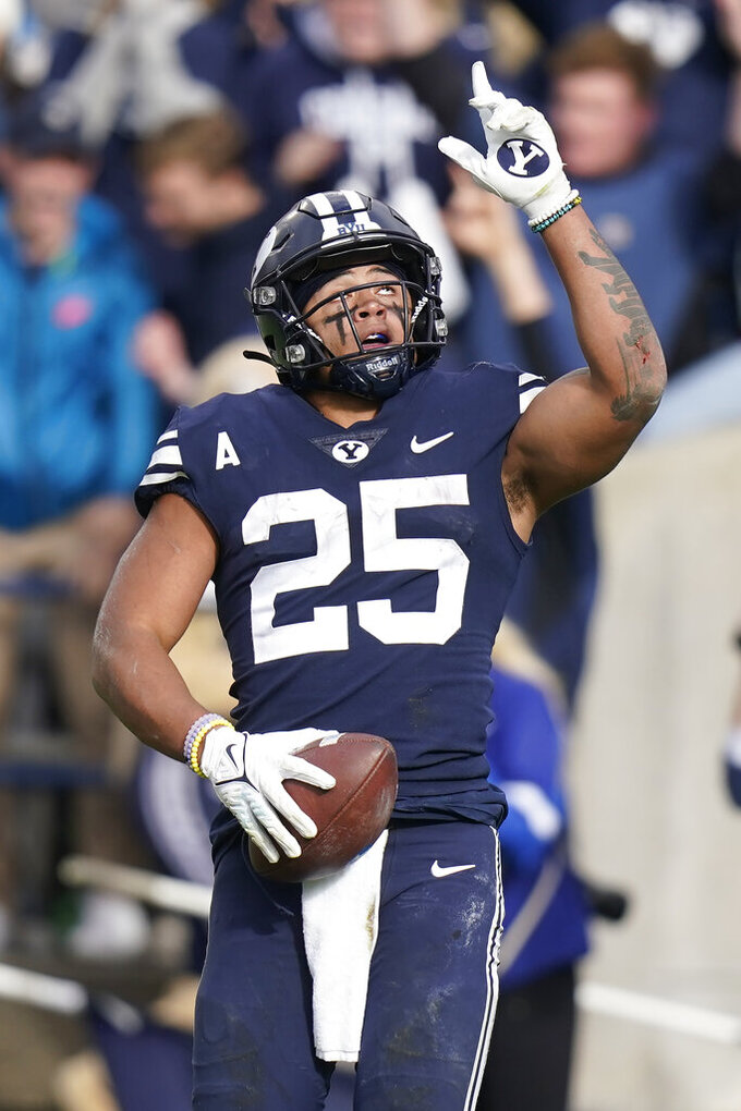BYU's Tyler Allgeier celebrates after scoring against Boise State in the second half during an NCAA college football game Saturday, Oct. 9, 2021, in Provo, Utah. (AP Photo/Rick Bowmer)