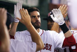 Boston Red Sox's J.D. Martinez is congratulated by teammates after his two-run home run off Kansas City Royals starting pitcher Glenn Sparkman during the fourth inning of a baseball game at Fenway Park in Boston, Wednesday, Aug. 7, 2019. (AP Photo/Charles Krupa)