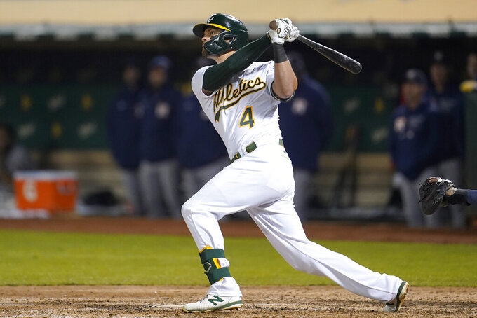 Oakland Athletics' Chad Pinder hits a grand slam home run against the Houston Astros during the seventh inning of a baseball game in Oakland, Calif., Friday, Sept. 24, 2021. (AP Photo/Jeff Chiu)