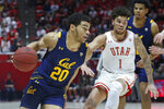 California guard Matt Bradley (20) drives around Utah forward Timmy Allen (1) during the first half of an NCAA college basketball game Saturday, Feb. 8, 2020, in Salt Lake City. (AP Photo/Rick Bowmer)