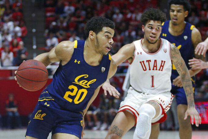 California guard Matt Bradley (20) drives around Utah forward Timmy Allen (1) during the first half of an NCAA college basketball game Saturday, Feb. 8, 2020, in Salt Lake City. (AP Photo/Rick Bowmer)
