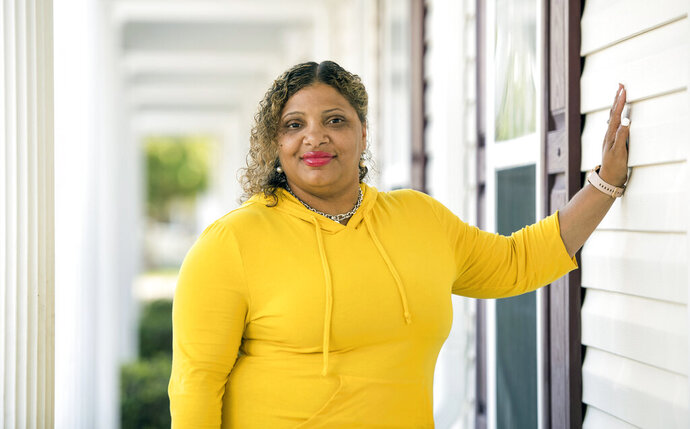 This photo provided by the ACLU show Janice Carter in South Carolina. South Carolina unconstitutionally suspends the drivers' licenses of people who haven't paid traffic tickets without first determining if they can afford to pay, according to a federal lawsuit filed Thursday, Oct. 31, 2019. Plaintiff Janice Carter, a 42-year-old Air Force veteran, said the policy leaves her with two unaffordable choices. To get her license reinstated, she said Thursday, she has to come up with $1,100 to cover past fines plus $500 for a reinstatement fee. (Sean Rayford/ACLU via AP)