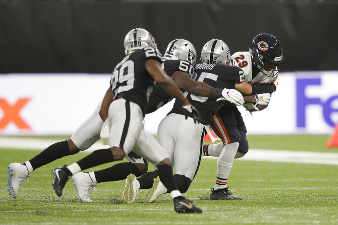 Chicago Bears running back Tarik Cohen (29) is tackled by Oakland Raiders free safety Erik Harris (25) during the first half of an NFL football game at Tottenham Hotspur Stadium, Sunday, Oct. 6, 2019, in London. (AP Photo/Tim Ireland)