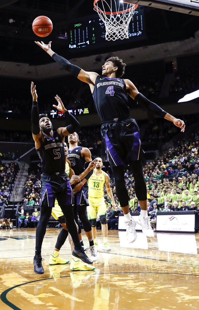 Washington holds off Oregon's late rally for 61-56 win