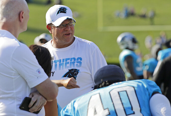 Carolina Panthers owner David Tepper watches his team during practice at the NFL football team's training camp in Spartanburg, N.C., Thursday, July 25, 2019. (AP Photo/Chuck Burton)