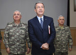 Turkey's Defence Minister Hulusi Akar listens during a meeting with the commanders of military units on Syrian border in Sanliurfa, southeastern Turkey, Friday, Jan. 11, 2019. Akar on an unannounced visit to troops stationed near the Syrian border reiterated Ankara is