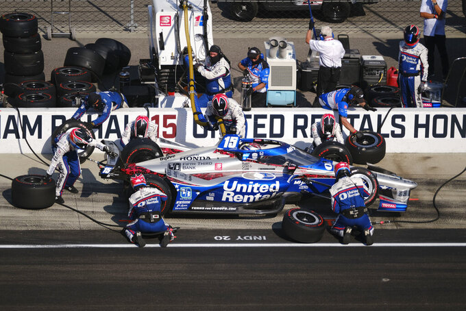 Graham Rahal makes his final pit stop during the Indianapolis 500 IndyCar auto race at the Indianapolis Motor Speedway, Sunday, Aug. 23, 2020, in Indianapolis. (AP Photo/AJ Mast)