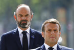 FILE - In this May 8, 2020 file photo, French President Emmanuel Macron, right, and French Prime Minister Edouard Philippe attend a ceremony to mark the 75th anniversary of the World War II victory over Nazi Germany, at the Arc de Triomphe in Paris. A new French prime minister will be appointed on Friday to replace Edouard Philippe, who has resigned amid an expected government reshuffle, the French presidency announced. (Charles Platiau/Pool via AP, File)