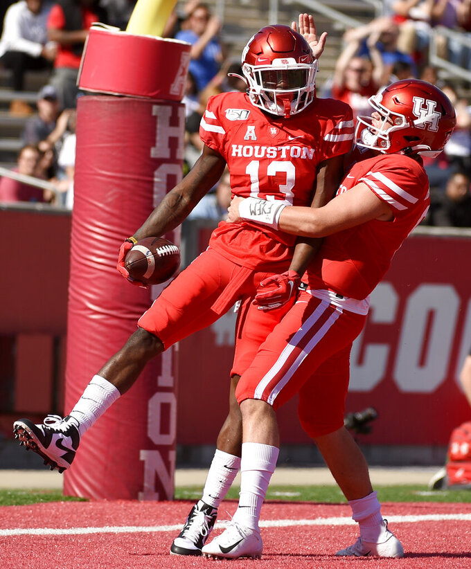 Houston wide receiver Jeremy Singleton (13) celebrates his touchdown with Logan Holgorsen during the first half of an NCAA college football game against Cincinnati, Saturday, Oct. 12, 2019, in Houston. (AP Photo/Eric Christian Smith)