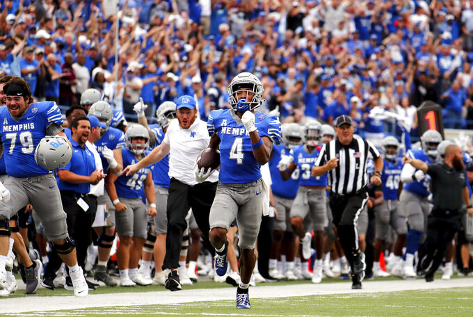Memphis receiver Calvin Austin III (4) returns a long punt against Mississippi State during an NCAA college football game Saturday, Sept. 18, 2021, in Memphis, Tenn. (Patrick Lantrip/Daily Memphian via AP)