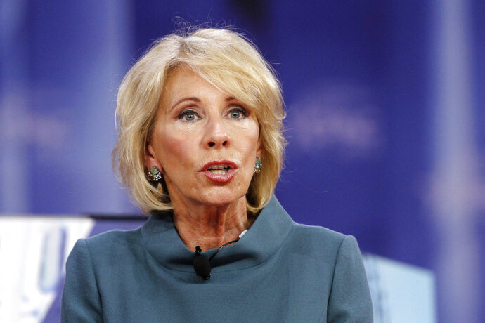 FILE - In this Feb. 22, 2018, file photo, Education Secretary Betsy DeVos speaks during the Conservative Political Action Conference (CPAC), at National Harbor, Md. DeVos is getting less than a ringing endorsement from the White House after uncomfortable television interviews raised questions about her commitment to help underperforming schools and support for President Donald Trump's school safety proposal. (AP Photo/Jacquelyn Martin, File)