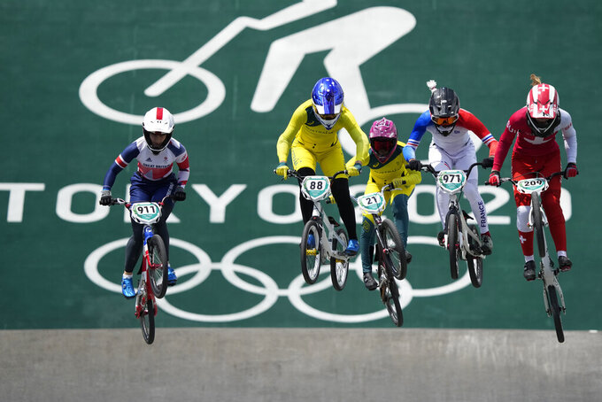 From left, Bethany Shriever of Britain, Saya Sakakibara of Australia, Lauren Reynolds of Australia, Manon Valentino of France, and Zoe Claessens of Switzerland compete in the women's BMX Racing quarterfinals at the 2020 Summer Olympics, Thursday, July 29, 2021, in Tokyo, Japan. (AP Photo/Ben Curtis)