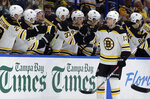 Boston Bruins center Charlie Coyle (13) celebrates with the bench after his goal against the Tampa Bay Lightning during the second period of an NHL hockey game Monday, March 25, 2019, in Tampa, Fla. (AP Photo/Chris O'Meara)