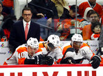 FILE - In this Dec. 31, 2018, file photo, Philadelphia Flyers interim head Scott Gordon, upper left, watches from the bench during the second period of an NHL hockey game against the Carolina Hurricanes, in Raleigh, N.C. The Hurricanes beat the Flyers 3-1. The Flyers crashed from a 98-point team that made the playoffs to the one of the worst teams in the NHL; they fired the coach, the general manager and play in front of a half-empty Wells Fargo Center where tickets bottomed out at $9 a pop on StubHub on Wednesday, Jan. 9, 2019. (AP Photo/Karl B DeBlaker, File)