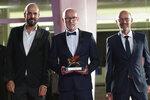 Disney's Marketing Director for Italy, Davide Romani, center, holds the Golden Lion Best Film award for