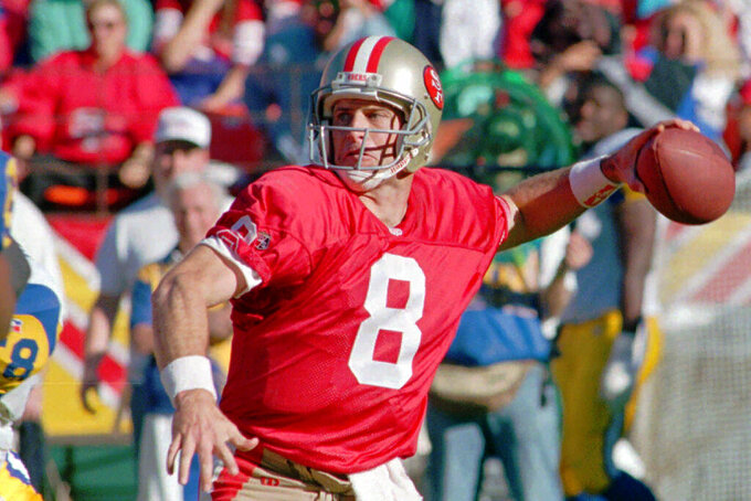 FILE - In this Nov. 26, 1995, file photo, San Francisco 49ers quarterback Steve Young throws against the St. Louis Rams in the first half of an NFL football game at San Francisco's 3Com Park. Miami Dolphins rookie Tua Tagovailoa is a rarity in the NFL: a left-handed quarterback. The last lefty to start a game was Kellen Moore in 2015. Hall of Famer Steve Young thinks he has the answer to why so few lefties are left: they're turned into defenders in pee-wee or high school. (AP Photo/Paul Sakuma, File)