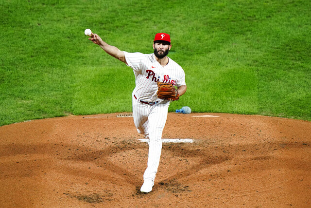 Philadelphia Phillies' Jake Arrieta pitches during the third inning of a baseball game against the New York Mets, Tuesday, Sept. 15, 2020, in Philadelphia. (AP Photo/Matt Slocum)