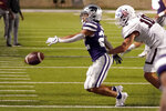 Kansas State running back Deuce Vaughn (22) can't reach a pass as he is chased by Southern Illinois linebacker Zach Burrola (10) during the second half of an NCAA college football game Saturday, Sept. 11, 2021, in Manhattan, Kan. Kansas State won 31-23 (AP Photo/Charlie Riedel)