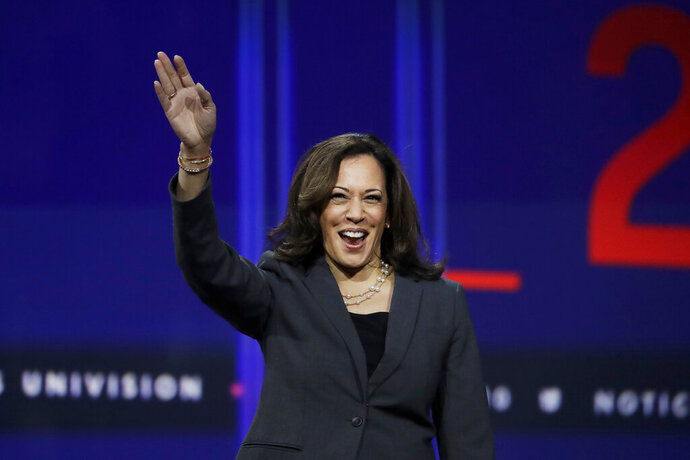 Sen. Kamala Harris, D-Calif., waves during a presidential forum at the California Democratic Party's convention Saturday, Nov. 16, 2019, in Long Beach, Calif. (AP Photo/Chris Carlson)