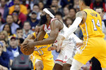 Los Angeles Lakers guard Avery Bradley (11) reaches in as Houston Rockets guard James Harden, middle, drives to the basket as Lakers guard Danny Green (14) watches during the first half of an NBA basketball game Saturday, Jan. 18, 2020, in Houston. (AP Photo/Michael Wyke)
