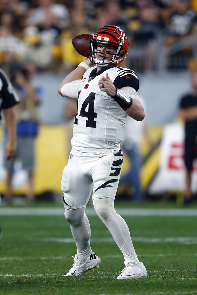 Cincinnati Bengals quarterback Andy Dalton (14) passes during the second half of an NFL football game against the Pittsburgh Steelers in Pittsburgh, Monday, Sept. 30, 2019. (AP Photo/Tom Puskar)