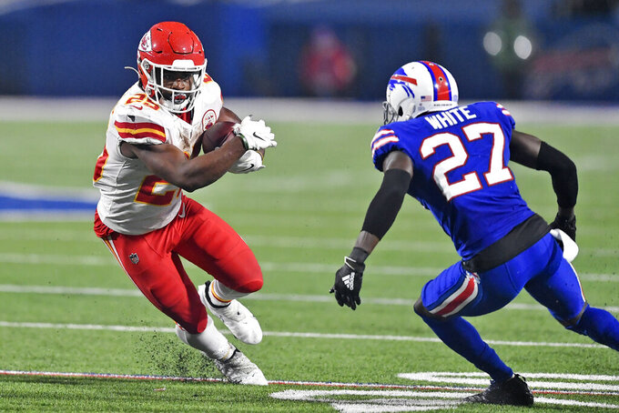 Kansas City Chiefs running back Clyde Edwards-Helaire (25) runs the ball as Buffalo Bills cornerback Tre'Davious White (27) defends during the second half of an NFL football game, Monday, Oct. 19, 2020, in Orchard Park, N.Y. (AP Photo/Adrian Kraus)