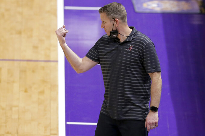 Alabama coach Nate Oats gives directions to the team during the second half of an NCAA college basketball game against LSU in Baton Rouge, La., Tuesday, Jan. 19, 2021. (AP Photo/Brett Duke)