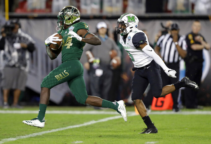 South Florida wide receiver Randall St. Felix (84) beats Marshall defensive back Chris Jackson (3) to the end zone on a 38-yard touchdown reception during the first half of the Gasparilla Bowl NCAA college football game Thursday, Dec. 20, 2018, in Tampa, Fla. (AP Photo/Chris O'Meara)