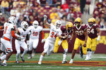Minnesota quarterback Tanner Morgan (2) runs with the ball against Bowling Green linebacker Brock Horne (34) during the first half of an NCAA college football game Saturday, Sept. 25, 2021, in Minneapolis. (AP Photo/Stacy Bengs)