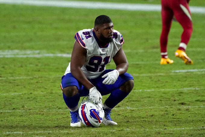 Buffalo Bills defensive tackle Ed Oliver (91) kneels after the Arizona Cardinals won an NFL football game, Sunday, Nov. 15, 2020, in Glendale, Ariz. The Cardinals won 32-20. (AP Photo/Rick Scuteri)