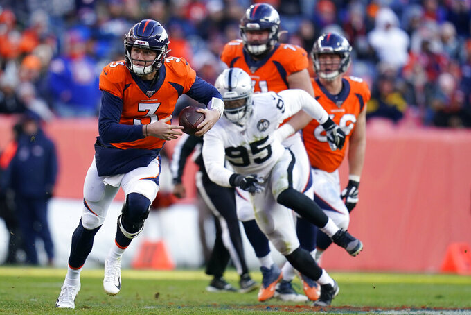 Denver Broncos quarterback Drew Lock runs with the ball during the first half of an NFL football game against the Oakland Raiders, Sunday, Dec. 29, 2019, in Denver. (AP Photo/Jack Dempsey)