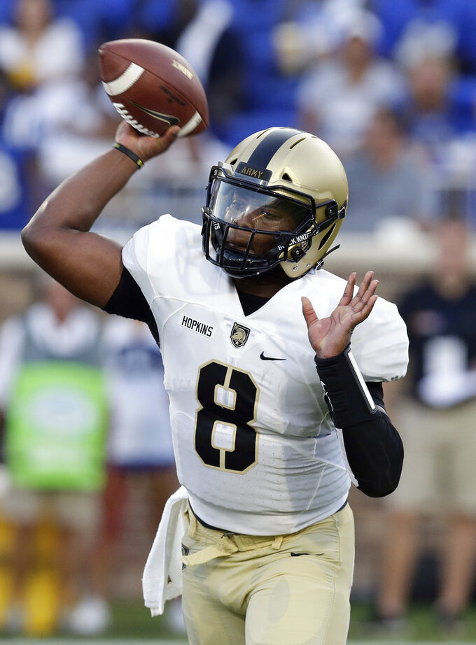 Army quarterback Kelvin Hopkins Jr. throws a pass during the first half of an NCAA college football game against Duke in Durham, N.C., Friday, Aug. 31, 2018. (AP Photo/Gerry Broome)