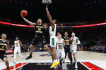 Northern Kentucky guard Tyler Sharpe (15) drives on Wright State guard Skyelar Potter during the first half of an NCAA college basketball game for the Horizon League men's tournament championship in Detroit, Tuesday, March 12, 2019. (AP Photo/Paul Sancya)