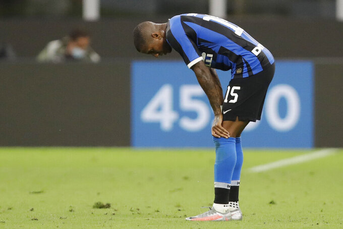 FILE -- In this July 22, 2020 file photo Inter Milan's Ashley Young gestures end of a Serie A soccer match between Inter Milan and Fiorentina, at the San Siro stadium in Milan, Italy. Ashley Young has tested positive for the coronavirus, becoming the sixth Nerazzurri player to contract the virus in the past week. (AP Photo/Luca Bruno)
