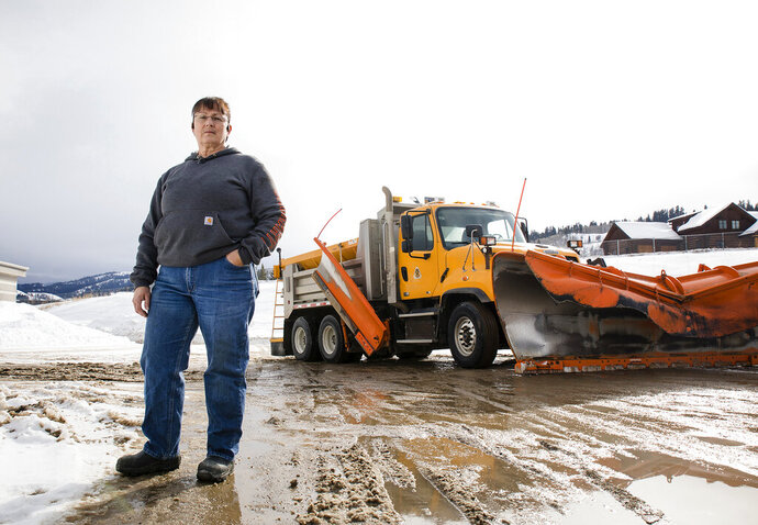 This Jan. 24, 2020 photo shows Shirley Samuelson standing for a portrait in Jackson, Wyo. With more than three decades of experience as a heavy equipment operator, Samuelson is the lone woman on a dedicated Wyoming Department of Transportation team that keeps the roads of Jackson and Teton Pass clear and safe for drivers throughout the long winter season.